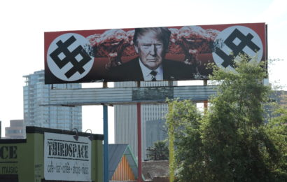 Trump Depicted with Swastika-Like Dollar Signs and Mushroom Clouds on Phoenix Billboard